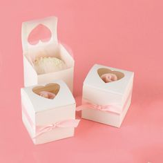 Cupcake Wedding Party Favor Boxes tied with pale pink ribbon.