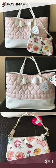 """Betsey Johnson 2 in 1 Tote & mini bag 2 Betsey bags for the price of one. Nice size Tote with a lot of room . Tote has snap button closure . Inside has one zip and two slip pockets . Exterior has signature Betsey quilted heart design Mini bag has cute floral design and zip closure. Measures height approx 11"""" and width approximately 18"""" . Mini bag height about 5"""" and width 9"""" Betsey Johnson Bags Totes"""