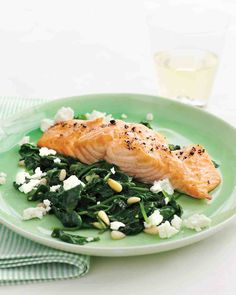 Fast and flavorful, this colorful dinner only takes 10 minutes to prepare: While salt-and-pepper-seasoned salmon fillets broil, saute fresh spinach just until tender, and toss with lemon juice, feta, and pine nuts.