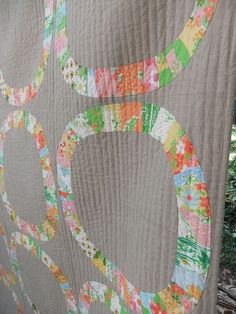 I love this single girl quilt with the linen background and vintage sheets scraps!