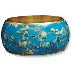 Fine art masterpiece to slip on your wrist. Van Gogh's 'Almond Blossoms,' richly lacquered on brass. Each is 1 1/2' wide, standard size (about 2 1/2' inside diameter). Made in India.