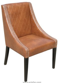 """Stylish and sophisticated sloping arm chair, this chair can be used for either dining or lounging. Features elegant diamond stitching on the seat back and sculpted track arms finished with a double row of silver nail head. available in Grey, Black, Ivory and Cognac bonded leather with matte black legs.    Dimensions: 23.5L x 24.5W x 37H inches x seat height 19"""""""