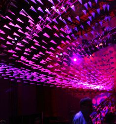 Matthew Parker Events created this stunning room for a non-profit arts group called ArtsFund in Seattle. Over 1,000 paper airplanes were made using recycled newsletters from the offices of ArtsFund and were hung on monofilament line from the balcony to the stage.