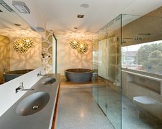 Modern bathroom with soaking tub and bamboo pendant lights