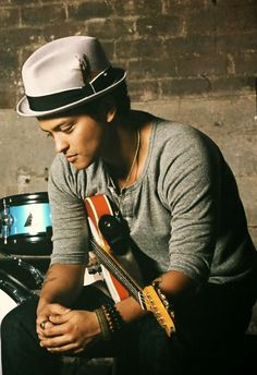 Peter Gene Hernandez (born October 8, 1985), known by his stage name Bruno Mars, is an American singer-songwriter and record producer. Raised in Honolulu, Hawaii, by a family of musicians, Mars began making music at a young age and performed in various musical venues in his hometown throughout his childhood.
