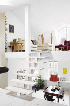 Beautiful! I love white and I love unique designs for stairs--especially floating stairs.