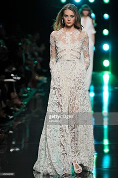 A model walks the runway at the Elie Saab Spring Summer 2015 fashion show during Paris Fashion Week on September 29, 2014 in Paris, France.