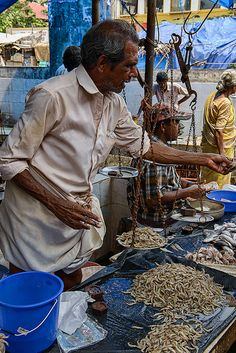 fish vendor at the market of Fort Cochin (Kochi), Kerala, India