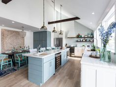 Any fans of HGTV's Drew and Jonathan Scott out there?) You might recognize this one from Brother Vs. Houston-based interior designer Beth Lindsey was the lead designe… Jonathan Scott, House Of Turquoise, Beach House Kitchens, Home Kitchens, Coastal Kitchens, Gold Kitchen, New Kitchen, Property Brothers Kitchen, Coastal Decor