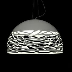 The Kelly suspended luminaire is a new and unique design by Andrea Tosetto. It's made of white metal with laser cut openings that create a game of light and shadows. The light bulbs are covered by a glass diffuser.
