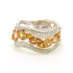 Waves of micro-pave diamond with etched milgrain are displayed in a unique assortment with various diamond shapes and colorful diamonds. This ring can be worn as a right-hand ring, cocktail ring, or s