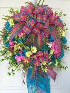 Bright Pink and Turquoise Spring and Summer Mesh Wreath by WilliamsFloral on Etsy https://www.etsy.com/listing/228306709/bright-pink-and-turquoise-spring-and