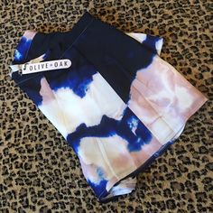 BNWT TIE DYE PRINT MINI FAUX SKORT Super fun for spring! Shades of navy, cobalt, dusty pink and cream. Love them loose with tank and denim jacket! Contemporary fitting. Tag says large but fits medium or small large. These are shorts but with drapey, soft fabric gives the appearance of a skirt- hence the name SKORT :) Shorts Skorts