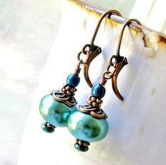 antique copper lever back earrings hold lovely teal green glass pearl rondelles accented by blue rainbow luster czech glass beads...    total