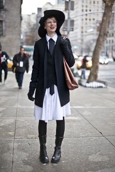 Streetpeeper.com Street Fashion Hat: Black Floppy Hat Jacket: Black Jacket Vest: Black Vest over Extra Long White Shirt with Grey Tie Stripe Shoes: Black Boots Photo By: Phil Oh