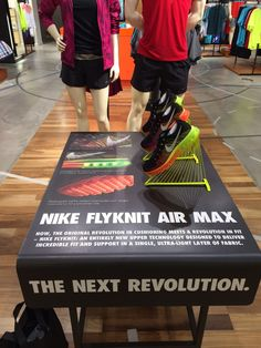 Nike Flyknit Air Max sports shoe retail table display.