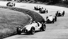 """thesecretring: """"German Grand Prix on the Nürburgring, July 25, 1937: Shortly after the start, in the southern hairpin bend, the Mercedes-Benz W 125 formula racing cars of Hermann Lang (start number..."""