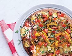 4-veggie pizza with zucchini, yellow bell peppers, cremini mushrooms, and red onion.