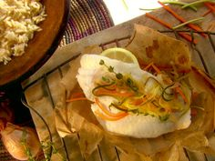 Fish en Papillote recipe from Melissa d'Arabian via Food Network   For variety, use any type of fish and any type of veggies