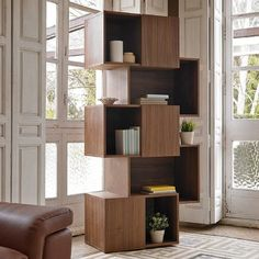 Crafted from solid teak wood, this bookcase is a statement addition to your living room. With its open-backed design, it also makes a great room divider in an open-plan space.