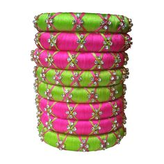 This lovely set of bangles has Pink & Parrot Green colored silk thread with Bright Stone & Cross Thread design on it. You can wear this at any occasion or with any matching dress. Silk Thread Bangles, Thread Jewellery, Jewelry, Green Silk, Pink And Green, Bangle Set, Stone, Parrot, Bright