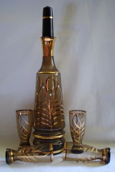 Mid Century Home Decor on this Etsy listing at https://www.etsy.com/listing/217418951/bohemian-decanter-and-4-glasses-gold-and