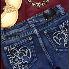 Embelished  jeans, Cropped ⚜Bling-Bling⚜ Fluer de Lis Embelished jeans, cropped. In very good used condition. Size 3 TAGS: Fluer de lis, Embelished Pocket Jeans, New Orleans, Saints, Distressed Red Rivet Jeans