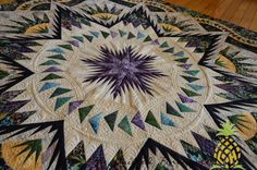 THE QUILTED PINEAPPLE: Glacier Star quilted by Linda