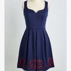 NWOT Modcloth Navy bloom dress NWOT Modcloth Navy fit & Flare bloom dress. Fun dress with sweetheart neckline , fitted bodice and full skirt . The red flowers are embroidered . As with most of modcloth's items it did not come with tags but is still in the packaging i received it in. This dress is true to size best for a 14/16 ModCloth Dresses