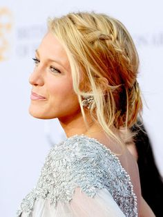 This side swept french braid with loose strands is perfect for a laid-back ceremony. #WeddingHair #BlakeLively