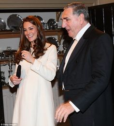 The Duchess of Cambridge chats to actor Jim Carter during an official visit to the set of Downton Abbey at Ealing Studios in March