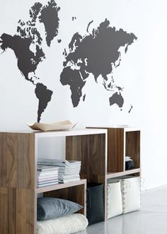 A map like this on a personal wall. With polaroid photos from trips pinned to every place visited.