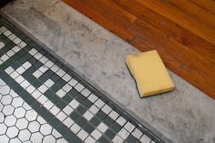 For small pieces of marble, like in an entryway, remove dirt with a scrub sponge, water and hydrogen peroxide. More tips on removing stains here.