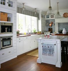 Traditional U-shaped White kitchen, white cabinets - like the upper cabinets and lights