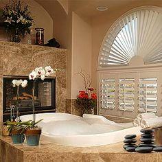 bathroom tub w/ a fireplace...sweet!