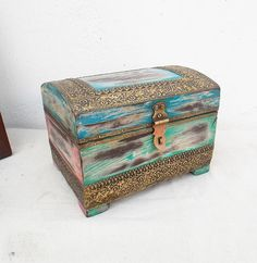 Indune Blue & Pink Rustic Wooden Box  This  Jewellery / Treasure Box  is made of wood & brass, it weights 970gms. Being handmade, some variation in dimension, design, shade or color is natural. In fact, these variations bestow the charm, character and authenticity to the creations. It can be used as Jewellery and Tressure box as well as a Shpowpiece because of the beautiful art work done on  it.