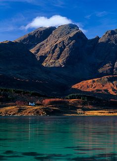 Torrin, Isle of Skye, Scotland.  The isolated cottage seen in this image, portrays a sense of the scale of Mt. Blaven or Blà Bheinn.