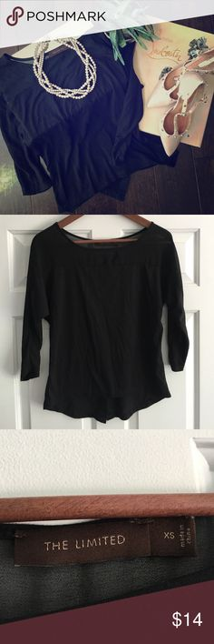 The Limited • Black Top with Sheer Cut-outs The Limited • Black Top with Sheer Cut-outs.  Button accents up back with quarter length sleeves.  High/low design.  Size XS; Excellent condition The Limited Tops Tees - Long Sleeve