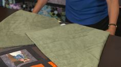 Learn how to fold a quilt to prevent damaging it. By folding a quilt in a certain direction you can minimize the breaking down of fabric fibers.