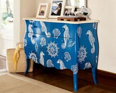 Nautical Entryway Cabinet from Pottery Barn - cheery blue and white with seahorses, shells and ships wheels. Could diy paint and stencil an old bureau, rather than shabby chic-ing it Nautical Entryway, Nautical Dresser, Blue Dresser, Coastal Dresser, Nautical Furniture, Coastal Furniture, Furniture Makeover, Diy Furniture, Furniture Design