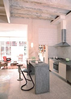 great industrial kitchen with narrow cement island