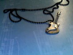 very rare guitar necklace. Must have jewelry piece for any inner rock star :)