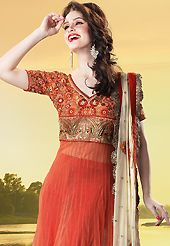 Dreamy variation on shape and forms compliment your style with tradition. The dazzling light rust net churidar suit have amazing embroidery patch work is done with resham, zari, sequins, stone, beads and lace work. Beautiful embroidery work on kameez is stunning. The entire ensemble makes an excellent wear. Contrasting red santoon churidar and cream net dupatta is available with this suit. Slight Color variations are possible due to differing screen and photograph resolutions.