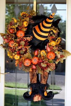 Great 2 in 1 wreath.  After Halloween, take off the hat and legs and any other goodies that go with Halloween, and you have a great wreath for November.  brought to you by looking for rainbows in the moonlight