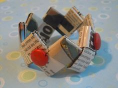Newspaper & Red Wood Beads