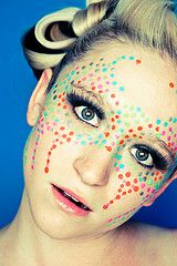 extreme makeup. Love the dots, very cool effect.