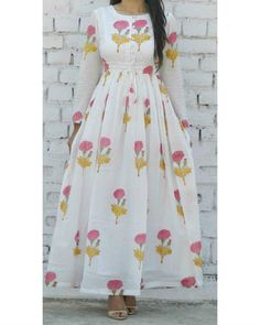 Buy The Secret Label White Cotton Printed Kurti online in India at best price.A boat neckline tie string maxi with buttons in the front and adjustable waist with drawstrings. Cotton Gowns, Cotton Long Dress, Designs For Dresses, Dress Neck Designs, Kurti Designs Party Wear, Kurta Designs, Blouse Designs, Indian Designer Outfits, Designer Dresses