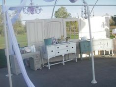 Beautiful old furniture pieces for wedding buffet.