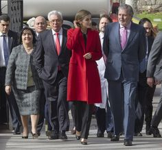 A Red Jacket Makes You Stand Out in a Sea of Gray Suits