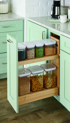 The new Base Pull-Out Out w/ Canisters comes with Seven OXO Good Grips POP containers fit neatly inside and can hold everything from cereal to nuts to pasta. The clear containers make it easy to see food and contents inside. #MarthaStewartLiving Kitchens at The Home Depot.